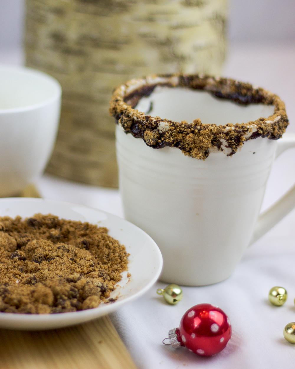 To elevate hot chocolate for the holidays, rim your mugs with chocolate and cookies